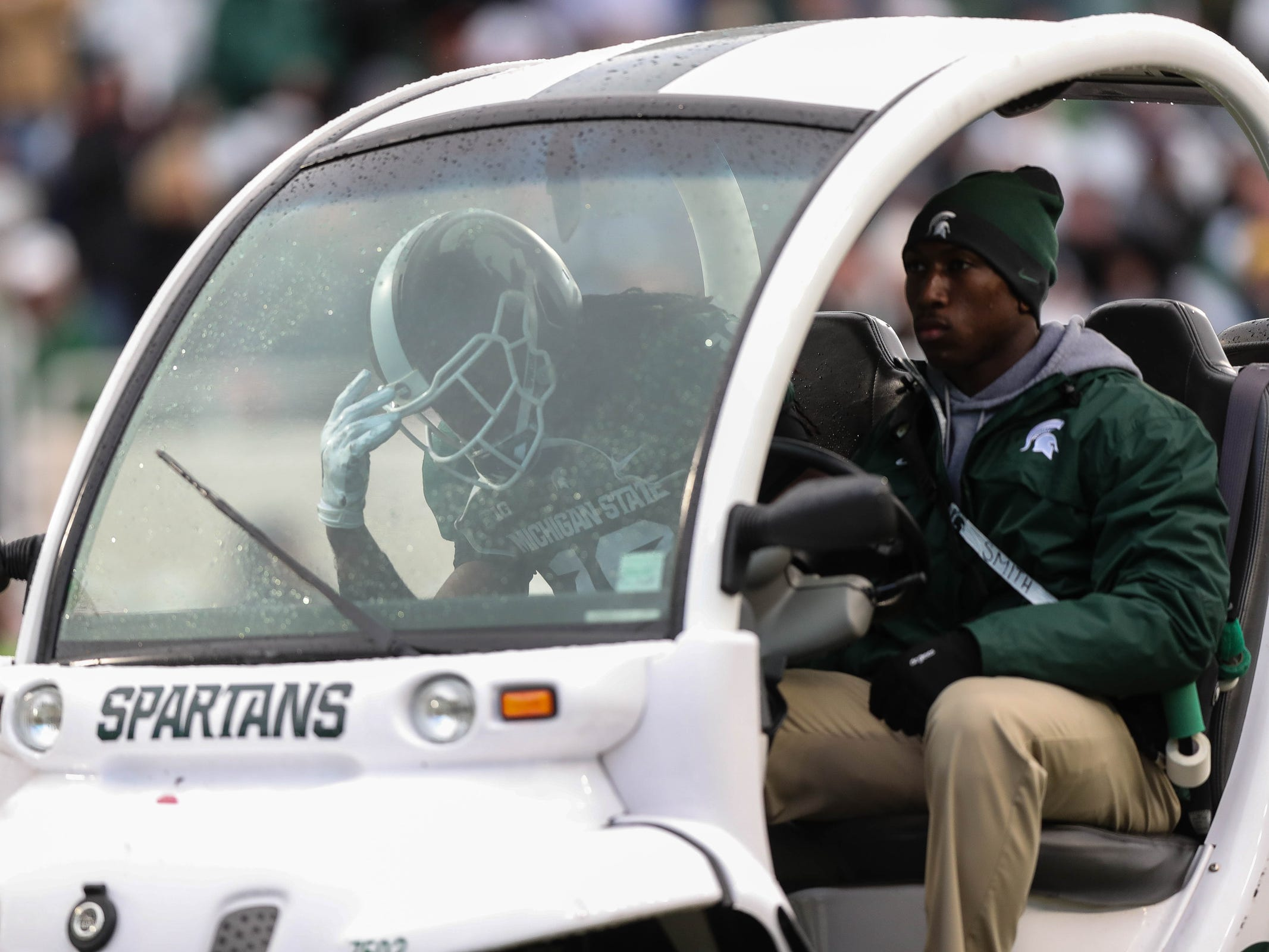 Michigan State's Felton Davis III, left, is carted off the field after injuring his left Achilles' tendon against Michigan, Saturday, Oct. 20, 2018 at Spartan Stadium in East Lansing.