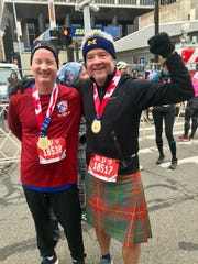 Mark Somerville, 49, of Novi ran the international half-marathon on Sunday, Oct. 21, 2018 at the Detroit Free Press/Chemical Bank Marathon. Also pictured: Tom Revnew, of Minneapolis.