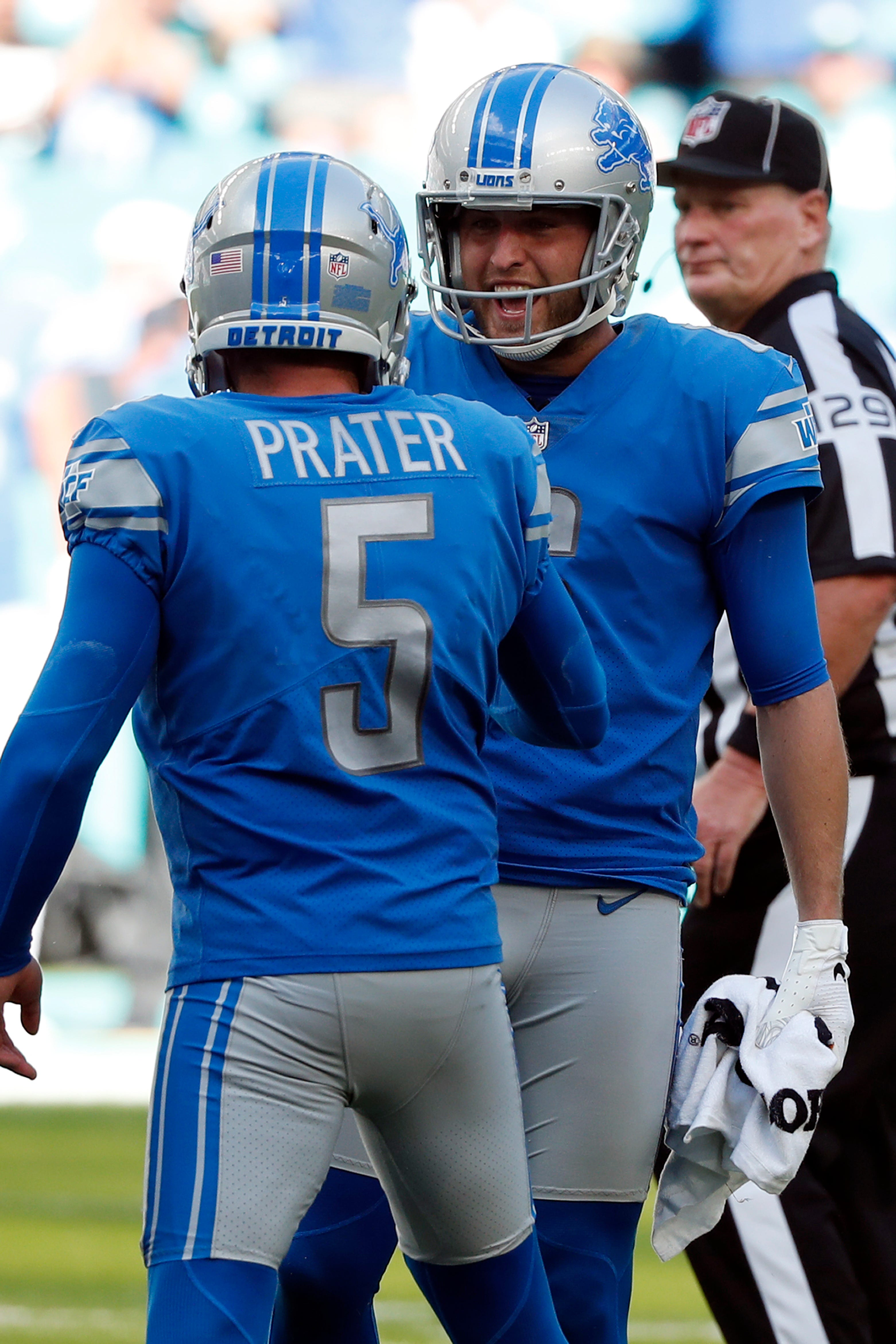 Lions punter Sam Martin celebrates a field goal with kicker Matt Prater during the second half of the Lions' 32-21 win on Sunday, Oct. 21, 2018, in Miami Gardens, Fla.