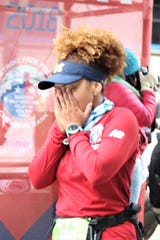 Malvina Reboucas of Ann Arbor is overcome with emotion after finishing the Detroit Free Press/Chemical Bank Marathon on Sunday, Oct. 21, 2016.
