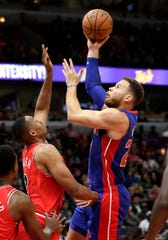 Detroit Pistons forward Blake Griffin shoots against Chicago Bulls forward Jabari Parker in the first half Saturday, Oct. 20, 2018, in Chicago.