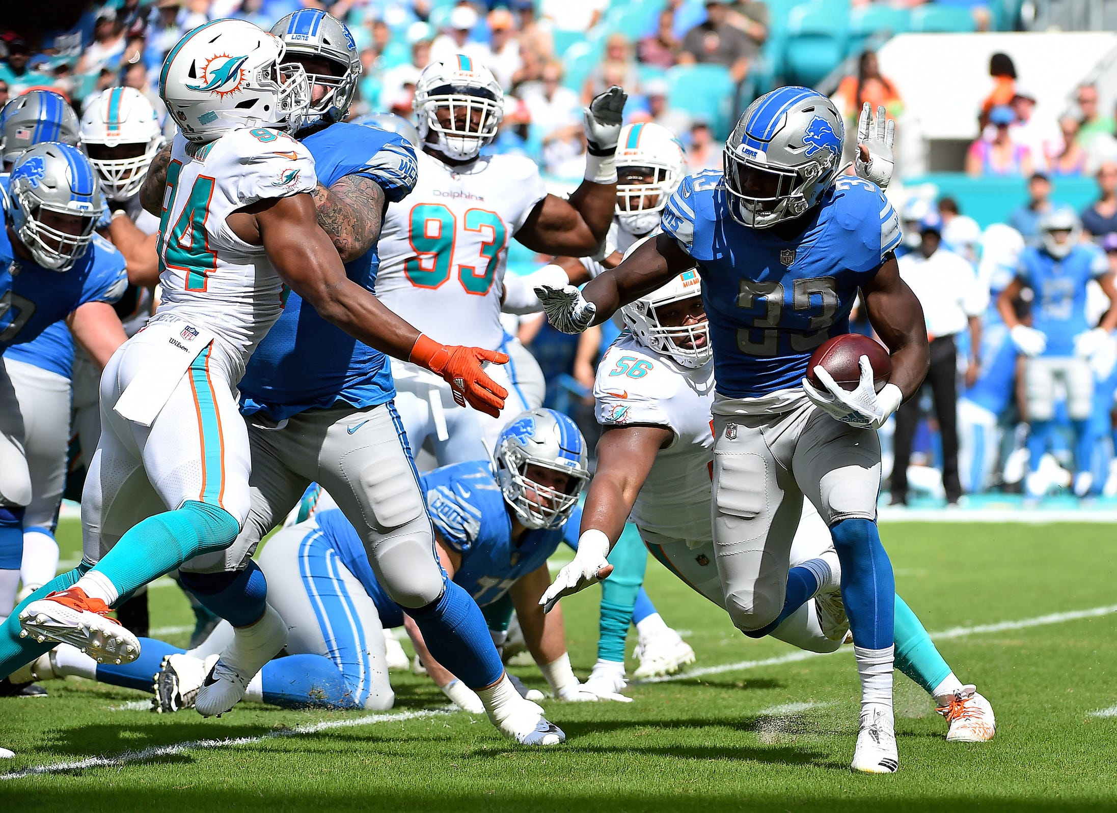 Lions running back Kerryon Johnson runs the ball during the first half on Sunday, Oct. 21, 2018, in Miami Gardens, Fla.