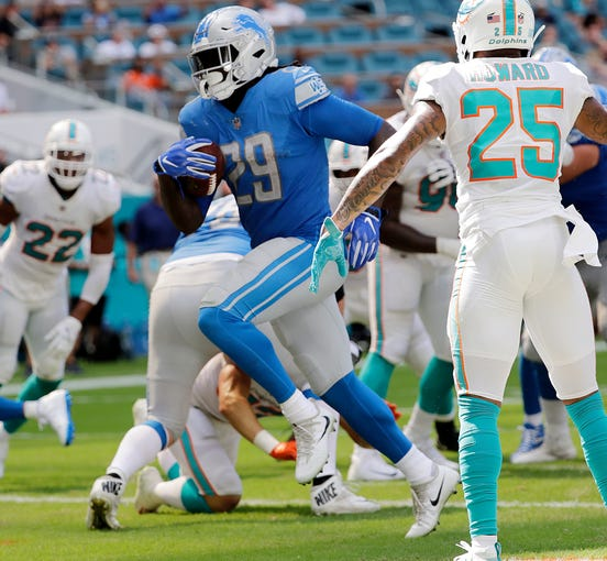 detroit lions 32 miami dolphins 21 photos