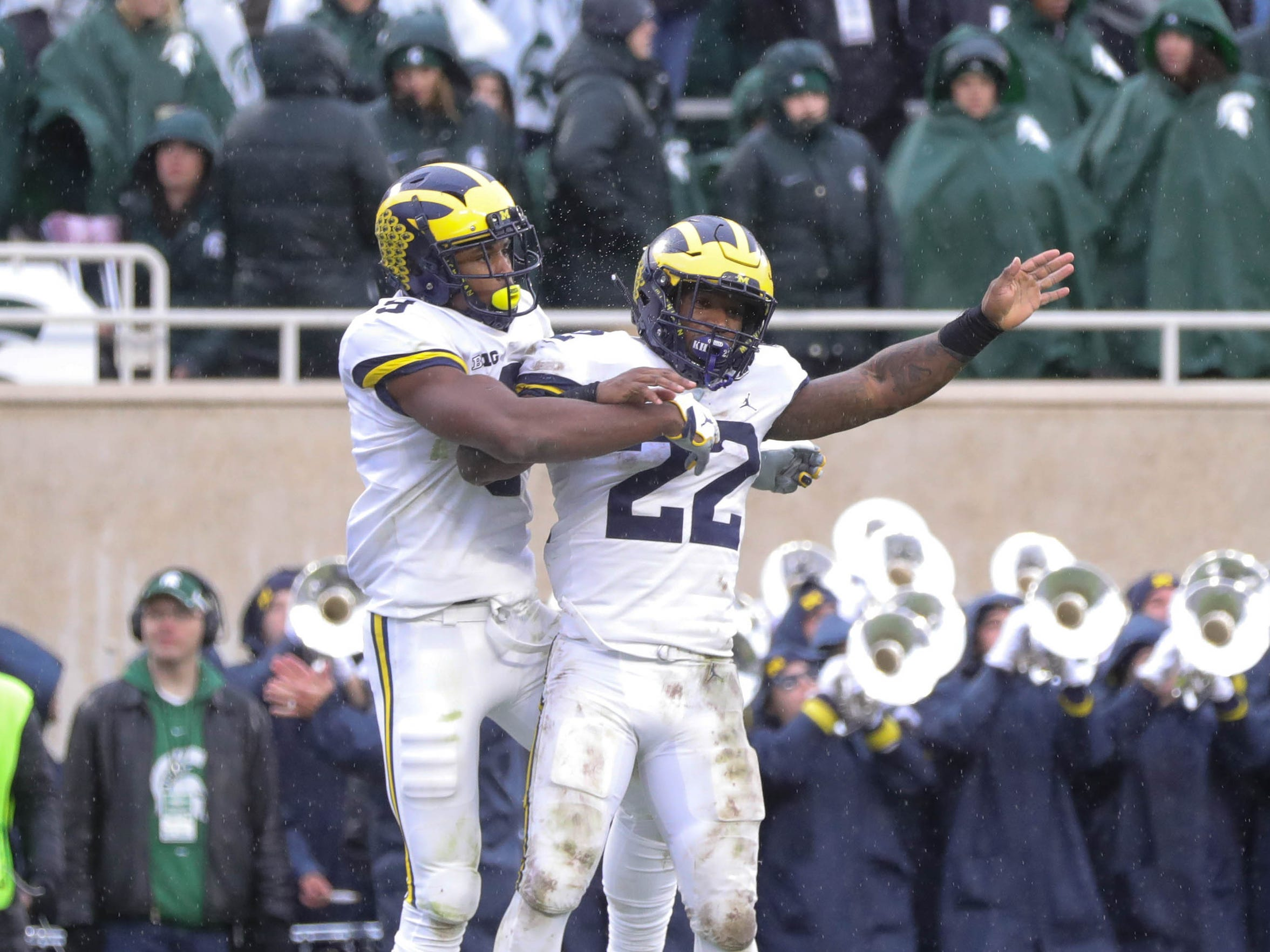 Michigan's Donovan Peoples-Jones (9) and Karan Higdon (22) celebrate Peoples-Jones' go-ahead touchdown against Michigan State in the third quarter Saturday, Oct. 20, 2018 at Spartan Stadium in East Lansing.