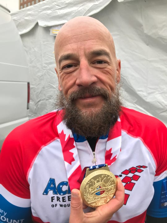 Tom Davis of Fremont, Indiana, won the 41st Detroit Free Press/Chemical Bank Marathon handcycle race on Sunday, Oct. 21, 2018.