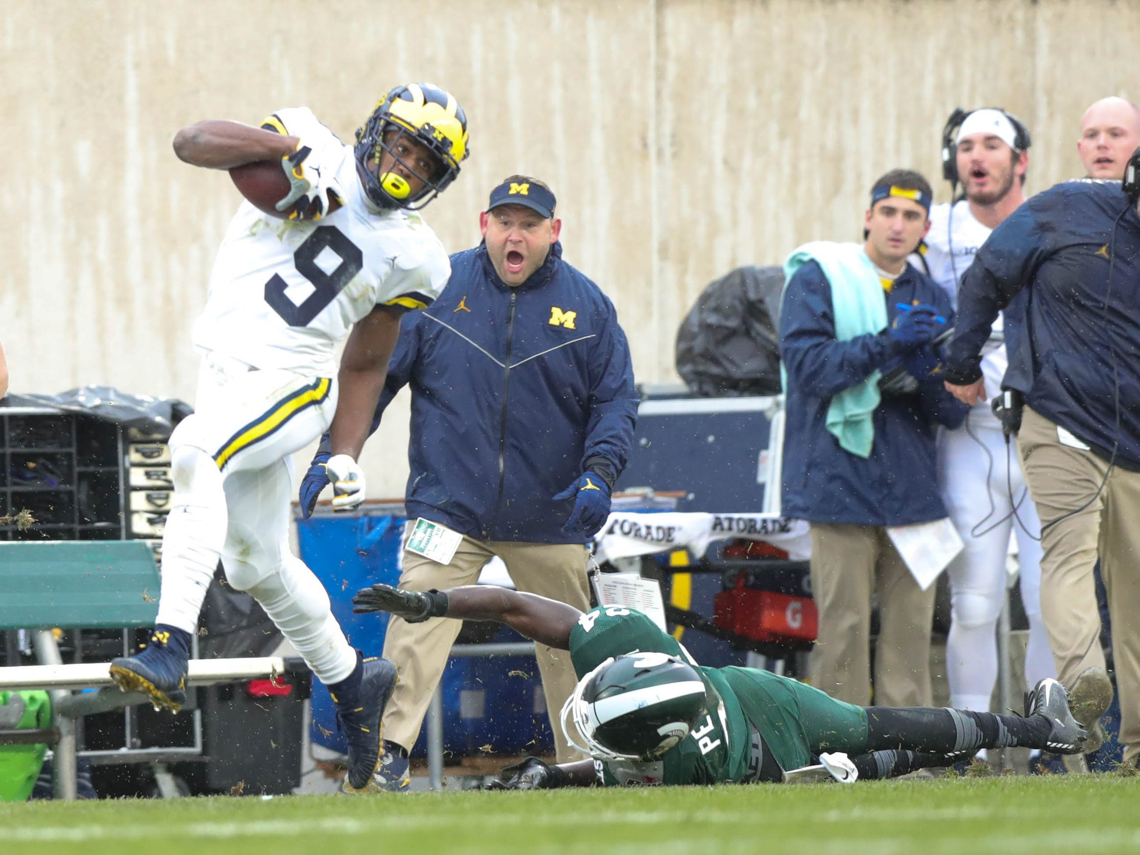 Michigan's Donovan Peoples-Jones catches the go-ahead touchdown pass against Michigan State's Tre Person during the third quarter Saturday, Oct. 20, 2018 at Spartan Stadium in East Lansing.