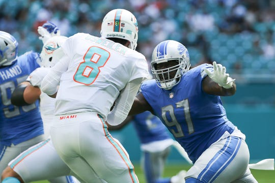 Lions defensive lineman Ricky Jean Francois sacks Dolphins quarterback Brock Osweiler during the first half of the Lions' 32-21 win Sunday, Oct. 21, 2018, in Miami Gardens, Fla.