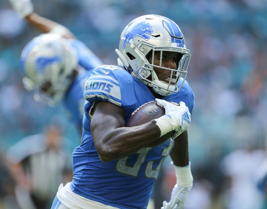Lions running back Kerryon Johnson runs with the ball against the Dolphins during the first half on Sunday, Oct. 21, 2018, in Miami Gardens, Fla.