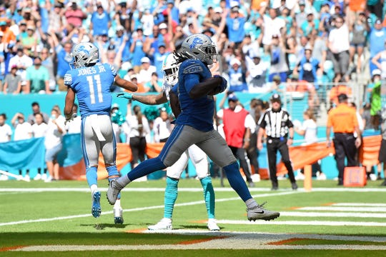 Lions running back LeGarrette Blount runs in for a touchdown against the Dolphins during the first half on Sunday, Oct. 21, 2018, in Miami Gardens, Fla.