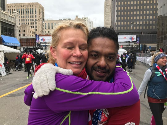 Kelly Steele, a running coach, hugs her latest protege -- Rony Brandi -- after the two residents of Windsor, Ont., finished the marathon together.