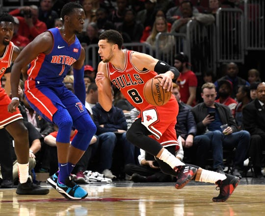 Chicago Bulls guard Zach LaVine drives against the defense of Detroit Pistons guard Reggie Jackson, during the first quarter at United Center, Oct. 20, 2018.
