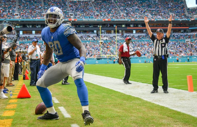 Michael Roberts celebrates after scoring a touchdown in the third quarter of the Lions' 32-21 win Sunday, Oct. 21, 2018, in Miami Gardens, Fla.