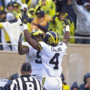 Michigan's Donovan Peoples-Jones (9) and Nico Collins (4) celebrate Peoples-Jones' go-ahead touchdown against Michigan State in the third quarter Saturday, Oct. 20, 2018 at Spartan Stadium in East Lansing.