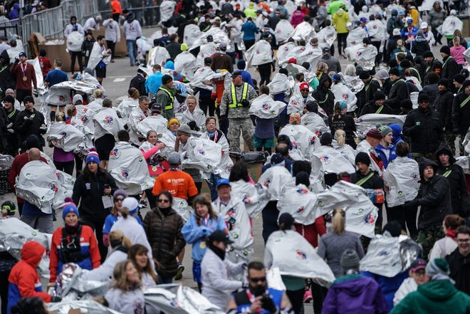 Runners get thermal blankets after running in the 41st Annual Detroit Free Press/Chemical Bank Marathon in Detroit on Sunday, Oct. 21, 2018.