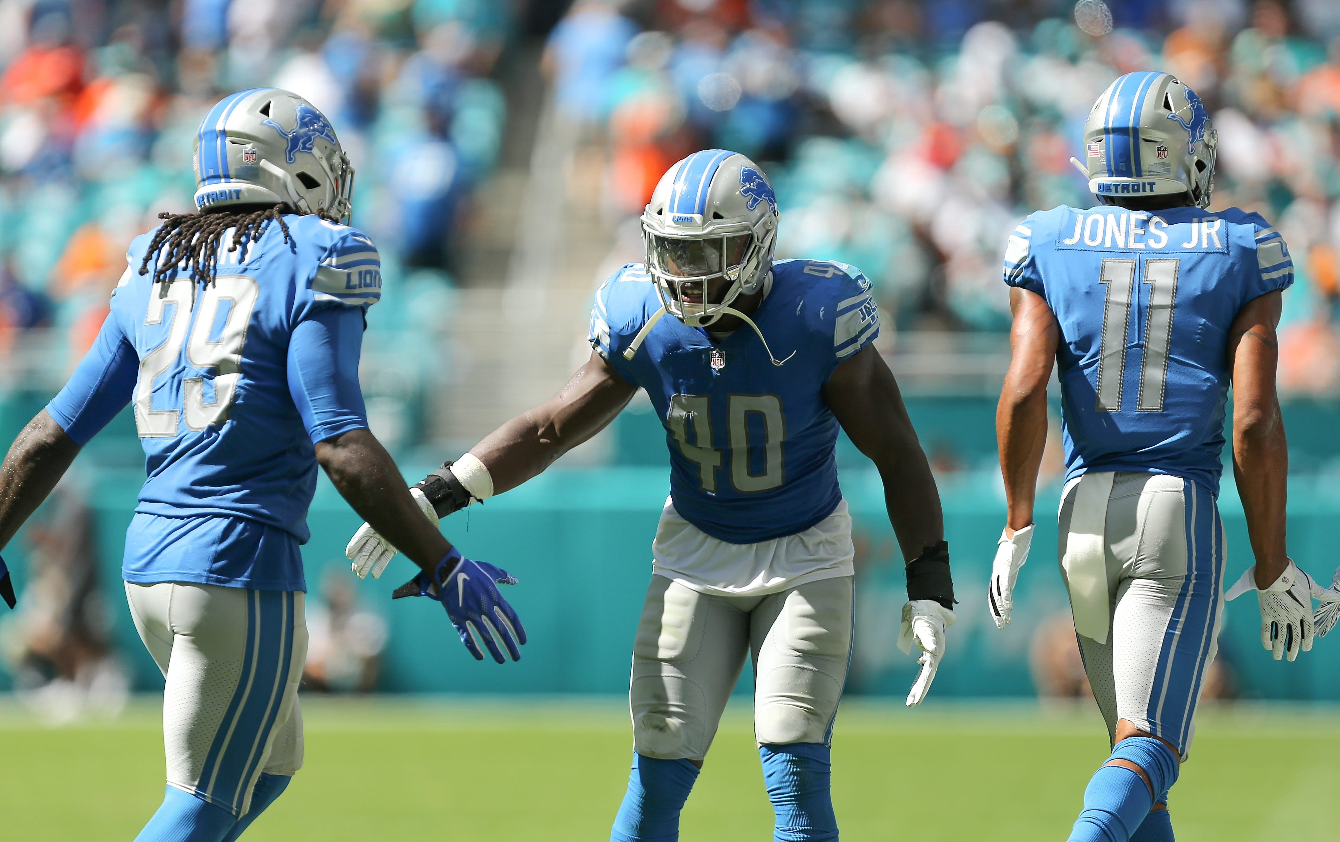 Lions linebacker Jarrad Davis, center, celebrates with LeGarrette Blount and Marvin Jones after a touchdown during the first half of the Lions' 32-21 win on Sunday, Oct. 21, 2018, in Miami Gardens, Fla.