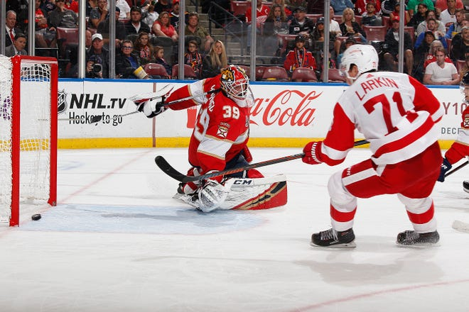 Dylan Larkin of the Red Wings scores a goal against goaltender Michael Hutchinson of the Panthers during second period action.