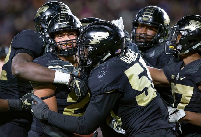Purdue's Markus Bailey (21) and members of the defense celebrate a touchdown against Ohio State on Saturday.