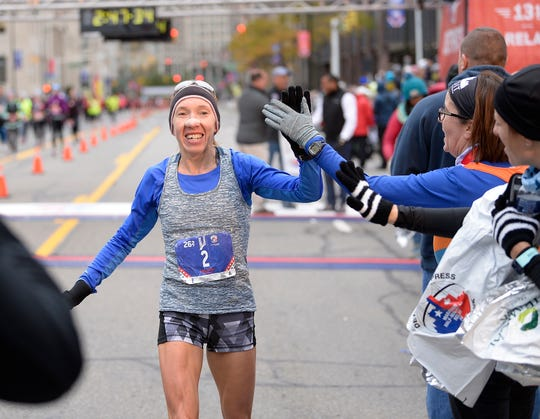 Lioudmila Kortchaguina, 47, of Canada, wins the women's division of the Detroit Marathon.