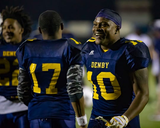 Jonathan Moreland of Detroit Denby celebrates with teammate Kobe Reeder after the win over Detroit Cody on Friday night.