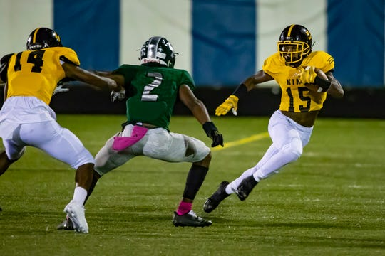 Dominick Polidore-Hannah of Detroit King tries to avoid a tackle in the PSL title game.