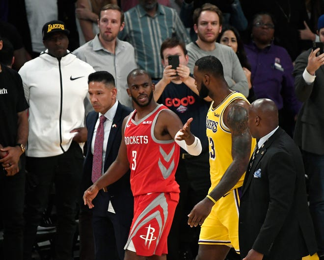 Chris Paul speaks with LeBron James after he was ejected for fighting during the second half of Saturday's game.
