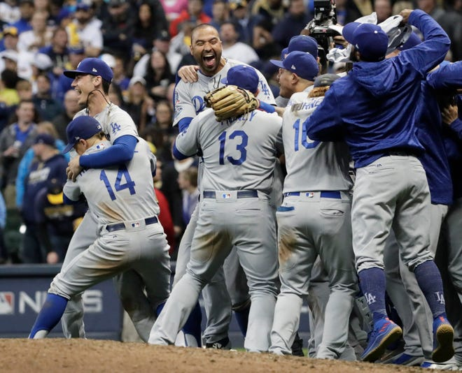 The Los Angeles Dodgers celebrate a 5-1 win against the Milwaukee Brewers in Game 7.