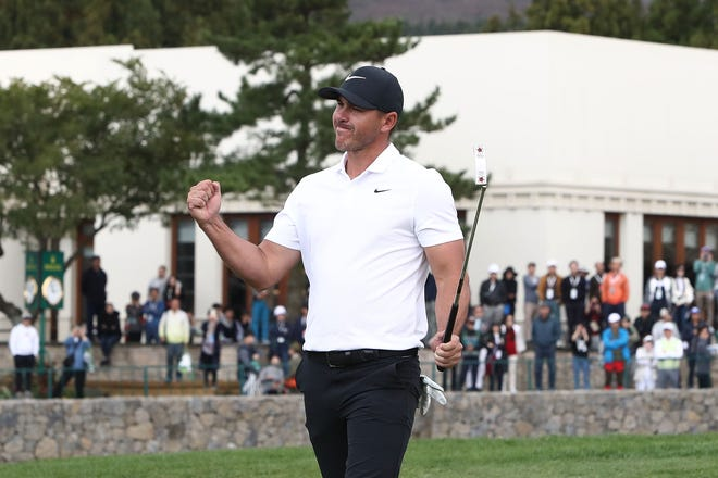 Brooks Koepka celebrates after wining putt on the 18th green during the final round of the CJ Cup at the Nine Bridges in Jeju, South Korea.
