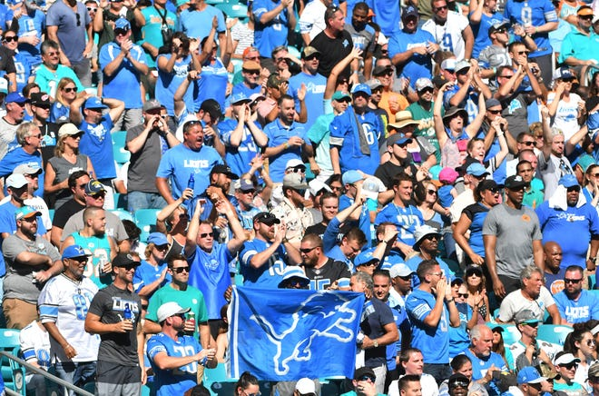 Lions fans fill the lower bowl stands late in the fourth quarter at Hard Rock Stadium in Miami.