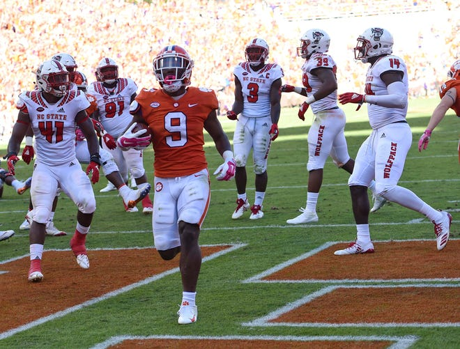 Clemson's Travis Etienne scores a touchdown against N.C. State during the first half on Saturday.