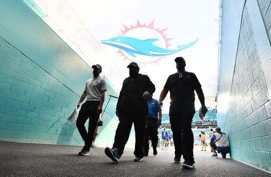 Lions head coach Matt Patricia, center, leaves the field after a 32-21 victory over the Miami Dolphins on Sunday.