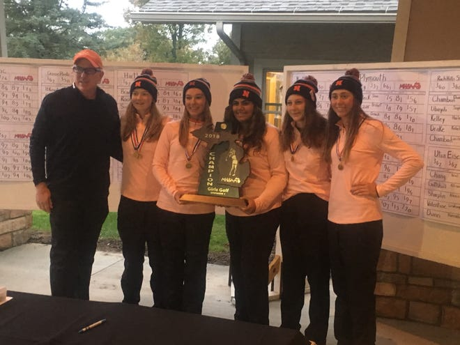 Northville closed its undefeated season Saturday in the wind and rain at Bedford Valley Golf Course in Battle Creek, winning the Division 1 title, beating Kensington Lakes Activities Association rival Plymouth by 31 strokes.
