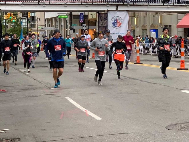 Runners in the the 41st running of the Detroit Marathon on Sunday in   downtown Detroit.