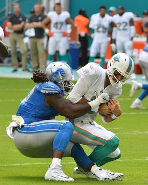 Lions' Ricky Jean Francois sacks Dolphins quarterback Brock Osweiler in the first quarter.