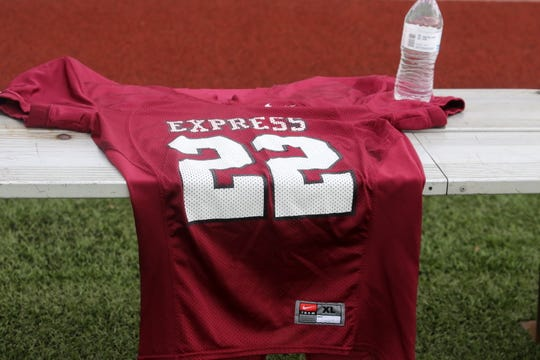 A jersey with the No. 22 worn by Eli Thomas sat on the bench during Elmira High School's game against Vestal on Oct. 20. Thomas, a linebacker at UConn, suffered a stroke Oct. 13.