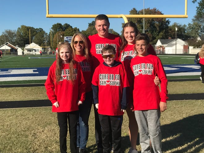 The Schulz family attended the 5th annual EB Walk at Memorial High School. Sophie (front left) and Sam (front center) have Epidermolysis bullosa, a skin disease.