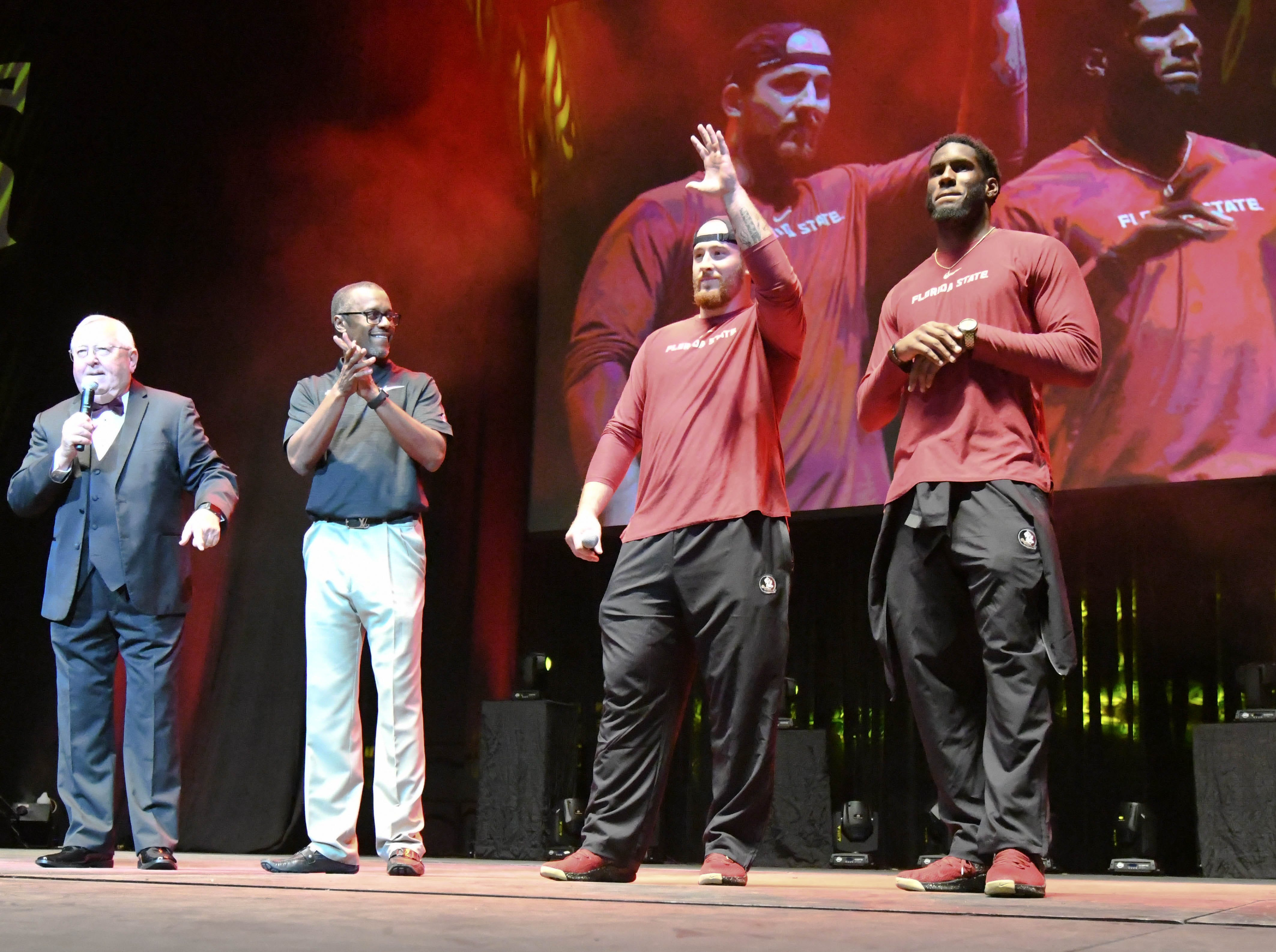 FSU head coach Willie Taggart, second from the left, and FSU football players Alec Eberle, second from the right, and Brian Burns, right, at PowWow in the Tucker Center on October 19, 2018.