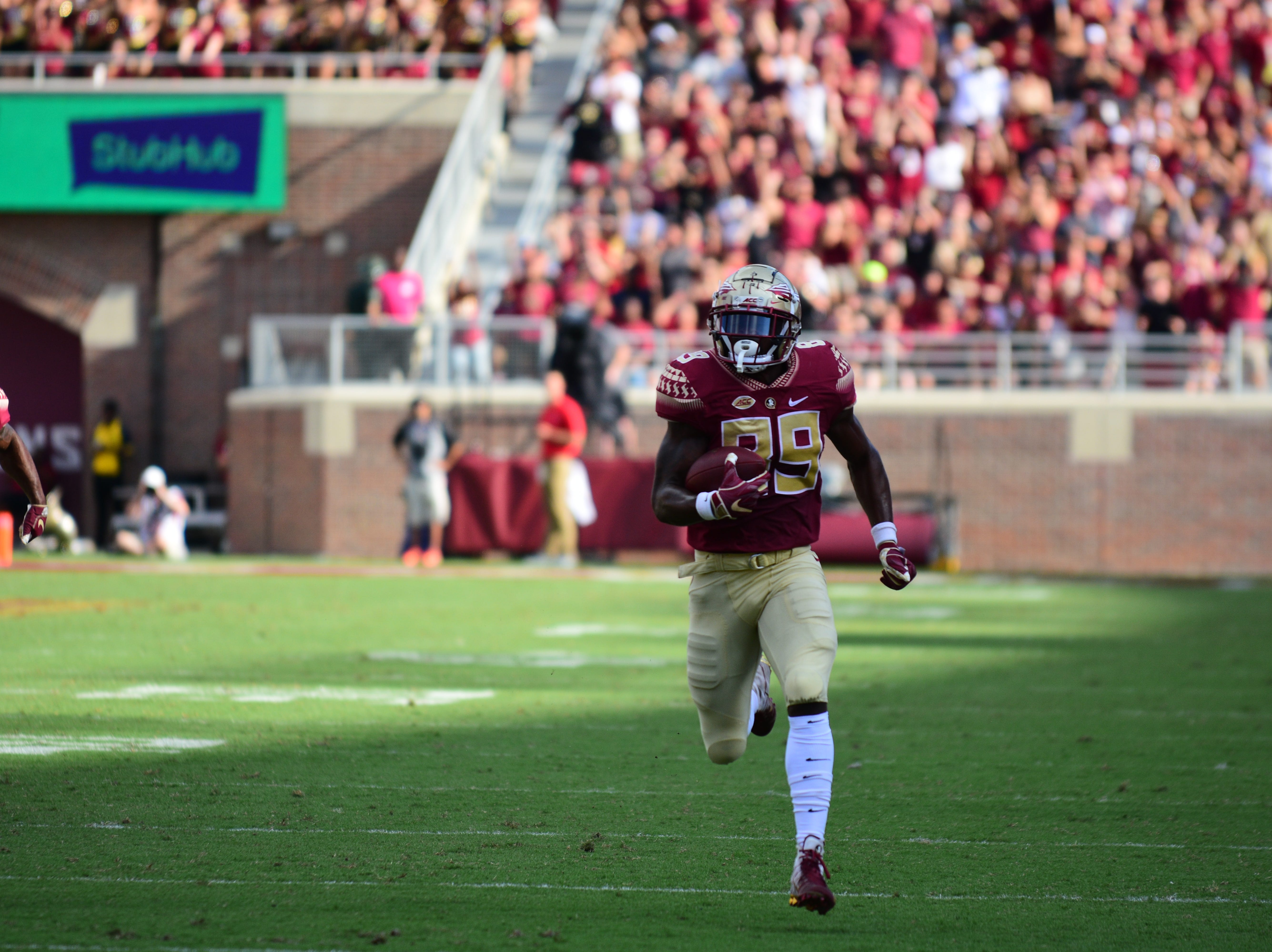Junior defensive end Brian Burns takes it to the house during FSU's 38-17 victory over Wake Forest at Doak Campbell Stadium on Saturday.