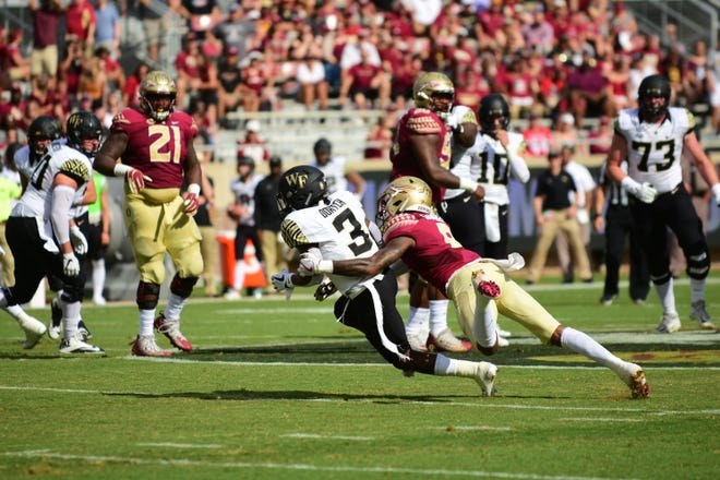 FSU sophomore defensive back Stanford Samuel III, 8, takes down Wake Forest redshirt wide receiver Greg Dortch, 3, during the second quarter of the Seminoles 38-17 victory over the Demon Deacons on Saturday.