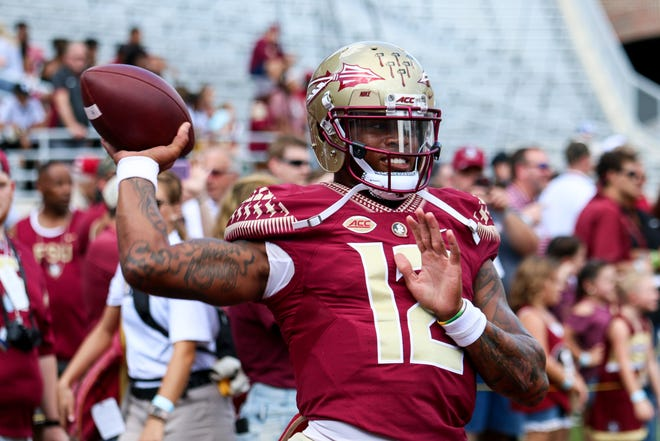 Deondre Francois (12) warms up before the football game on Saturday, Oct. 20 against Wake Forest at Doak Campbell Stadium.