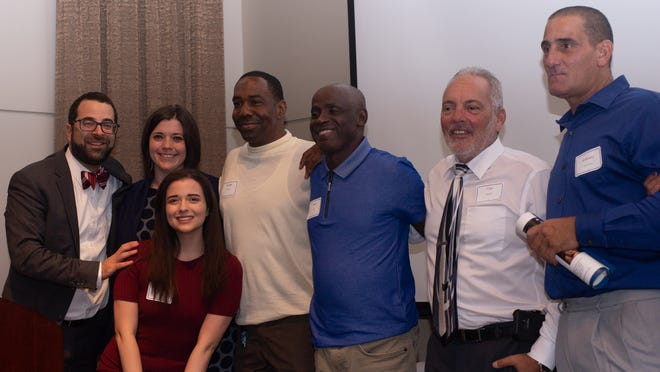 The Innocence Project of Florida staff with a few of their exonerees at their annual Steppin' Out Gala in Tallahassee, Florida in May of 2018.