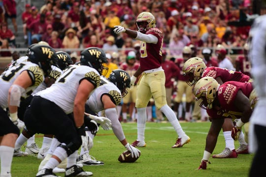 FSU junior defensive end Brian Burns, center, commands the defensive line during the game against Wake Forest in Tallahassee on Saturday.