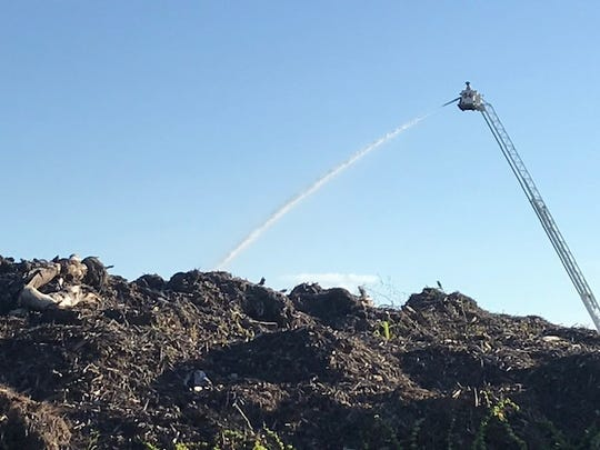 San Carlos Fire Department units continued pouring water Sunday on a mulch fire at MW Horticulture Recycling on Thomas Road in south Lee County, a day after firefighters were called in to try to control the blaze.