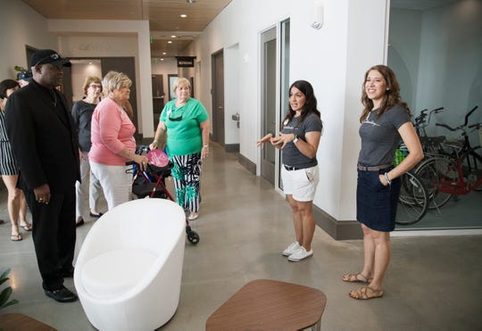 Tessa Lesage, second from right, and Katie Leone, of the Southwest Florida Community Foundation, lead a tour of the foundation's new home, the Collaboratory, on October 21, 2018 in downtown Fort Myers. The foundation modernized the old downtown train depot that is now the Collaboratory.