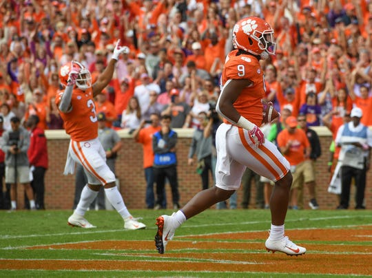 Clemson running back Travis Etienne (9) scores against NC State during the 1st quarter Saturday, October 20, 2018 at Clemson's Memorial Stadium.
