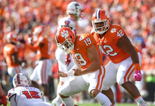 Clemson defensive back Tanner Muse (19) reacts after sacking NC State quarterback Ryan Finley (15) during the 1st quarter Saturday, October 20, 2018 at Clemson's Memorial Stadium.