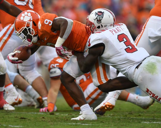 NC State linebacker Germaine Pratt (3) brings down Clemson running back Travis Etienne (9) during the 4th quarter Saturday, October 20, 2018 at Clemson's Memorial Stadium.