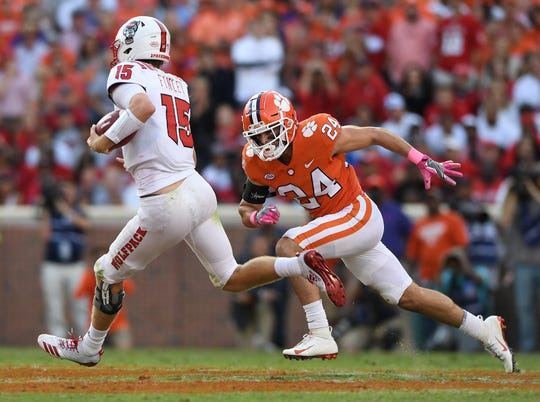 Clemson safety Nolan Turner (24) closes in on NC State quarterback Ryan Finley (15) during the 3rd quarter Saturday, October 20, 2018 at Clemson's Memorial Stadium.