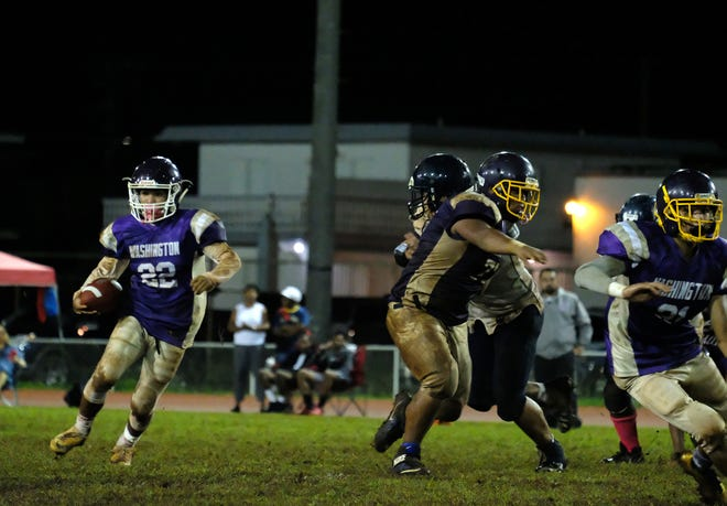 George Washington Geckos Jesse Manglona runs the ball during the game against the Guam High Panthers in the 2018 IIAAG high school football semifinals October 20, 2018.