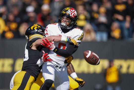Iowa cornerback Riley Moss knocks the ball out of Maryland receiver Jahrvis Davenport's hands on Saturday, Oct. 20, 2018, at Kinnick Stadium in Iowa City.
