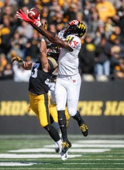 Iowa cornerback Riley Moss breaks up a pass play against Maryland on Saturday, Oct. 20, 2018, at Kinnick Stadium in Iowa City.